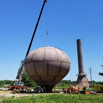 lindblad construction crane putting top of water tower in place